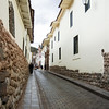 Inca stone walls along narrow cobbled street, Cuzco, Peru