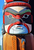 TotPol 00401 A superb, well carved, excellent condition, masked human holding a spear totem pole located near water totem pole detail picture by Peter J  Mancus