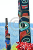 TotPol 00855 Two tall well carved, excellent condition, colorful, totem poles near a foothill totem pole detail picture by Peter J  Mancus