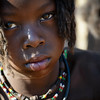 A young Himba girl in Otjikandero Village, Damara Land, Namibia.  Africa.