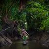 Timi in dugout canoe, Karawari River, PNG. model released.