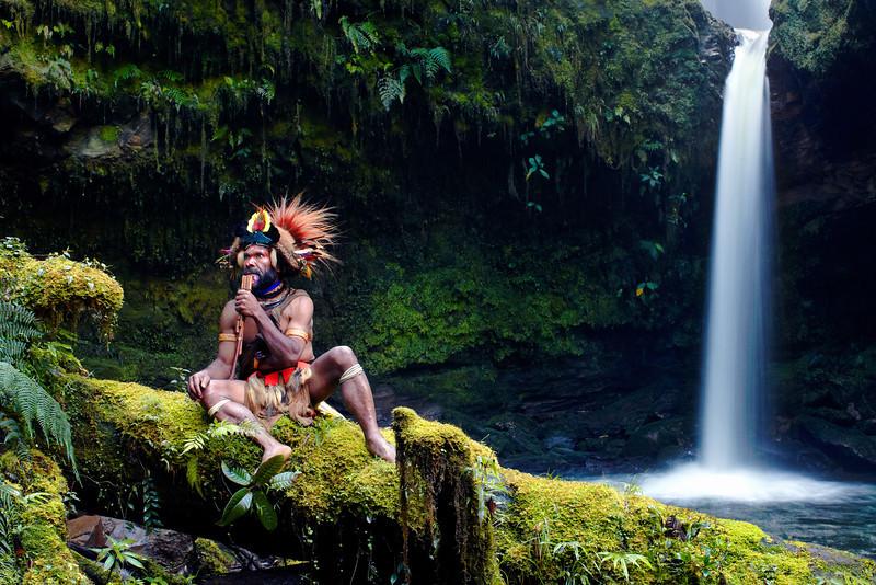 Huli Wigman plays his flute, Papua New Guinea highlands.