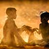 Himba children playing games in the sand, Otjikandero Village, Damara Land, Namibia.  Africa.