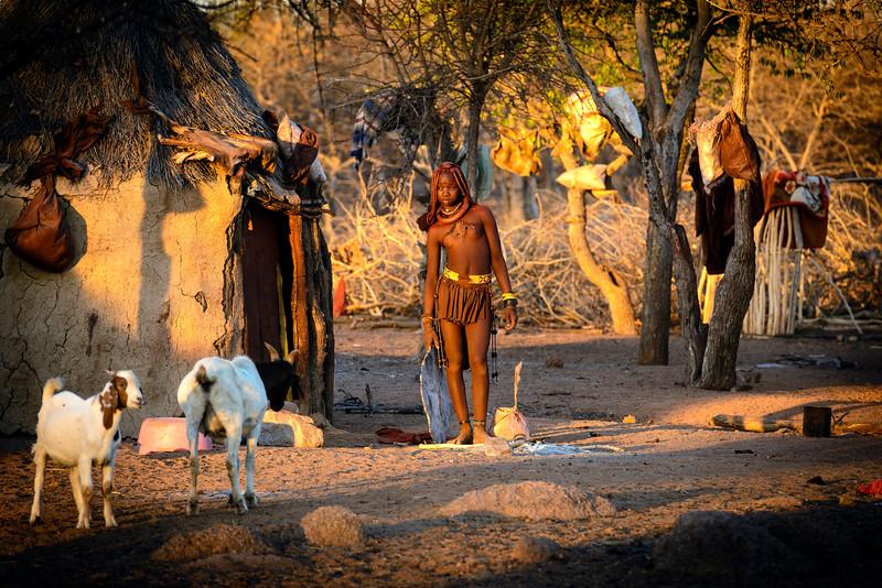 A Himba girl in her village, Damara land, Namibia, Africa