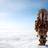 Inupiaq Eskimo woman overlooks the frozen Bering Sea.  Nome, Alaska