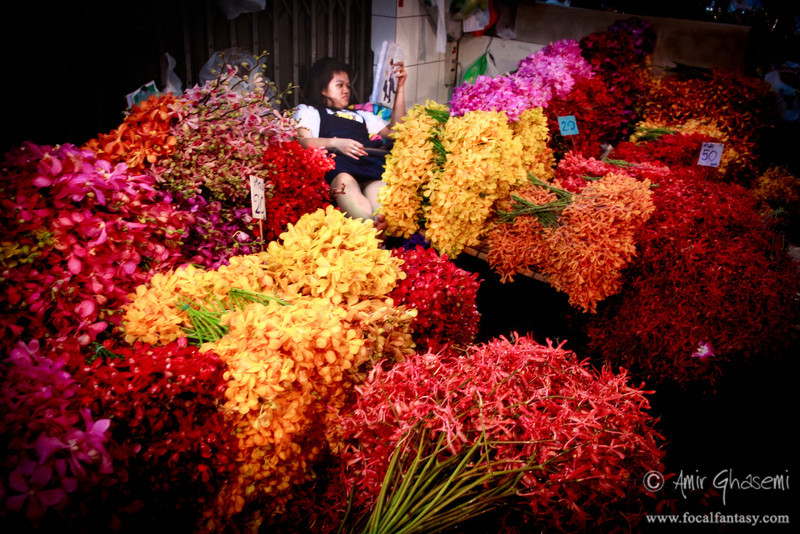 Flower seller, Pak Khlong Talaat flower market, Bangkok.