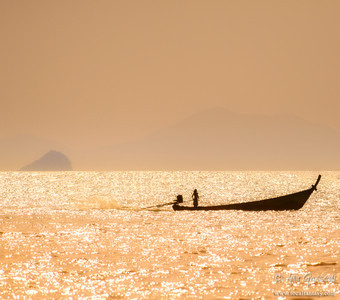 Longtail boat and its lady captain, Railay bay, Krabi.