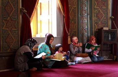 Muslim women praying at Sultan Mehmet Fatih turbesi (mausoleum).