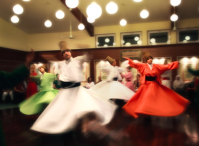 Ritual whirling during Sema ceremony performed by Mevlevi dervishes.
