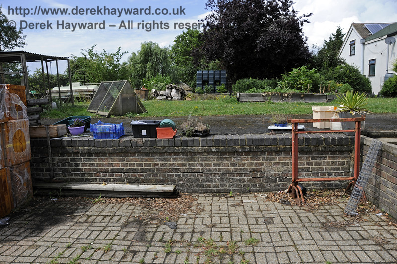 In 2014 part of the goods bay platform wall was still in existence at the former Barcombe Mills station.  The bay platform never had the usual white line along the edge as it was not used by passengers.  28.07.2014 11365.  Please note that this location is private property (I was there on Bluebell Railway business).