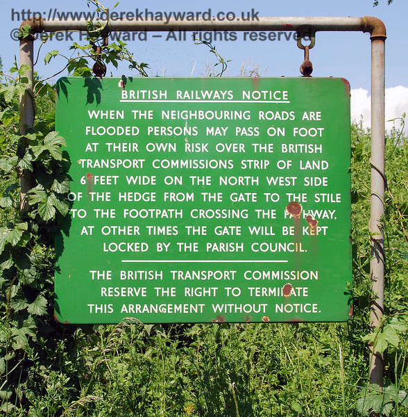 A much photographed and famous sign at Barcombe Mills explained by the tendency of the adjacent River Ouse to flood.  02.06.2007.   This sign was found to have been removed in 2013, and a much loved village heirloom was thereby lost.  Social media reports suggest that it was stolen.