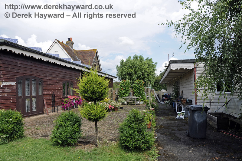 Barcombe Mills station, looking north along the infilled platforms, on 28.07.2014.  The buildings are two separate dwellings. 11366. Please note that this location is private property (I was there on Bluebell Railway business).