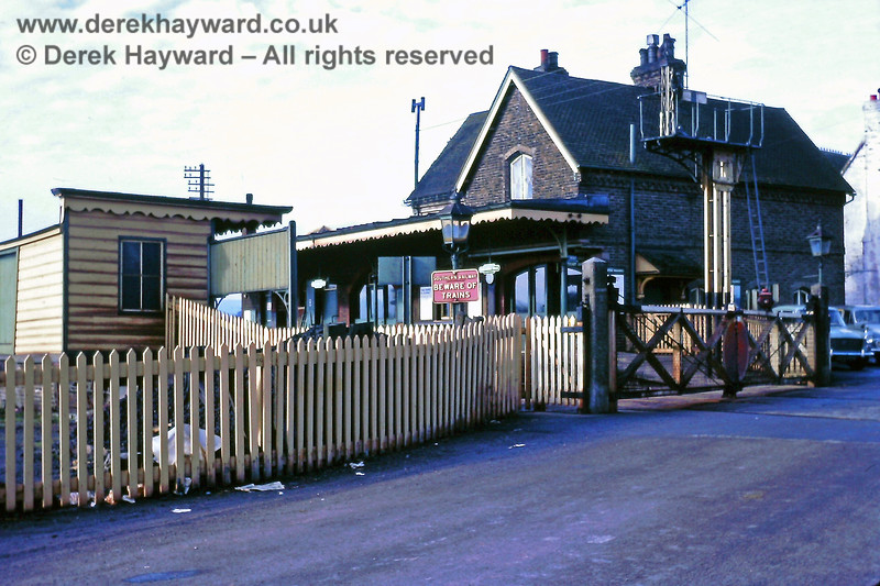 Barcombe Mills station, pictured from a point just east of the level crossing. 23.02.1969.  Eric Kemp retains all rights to this image.