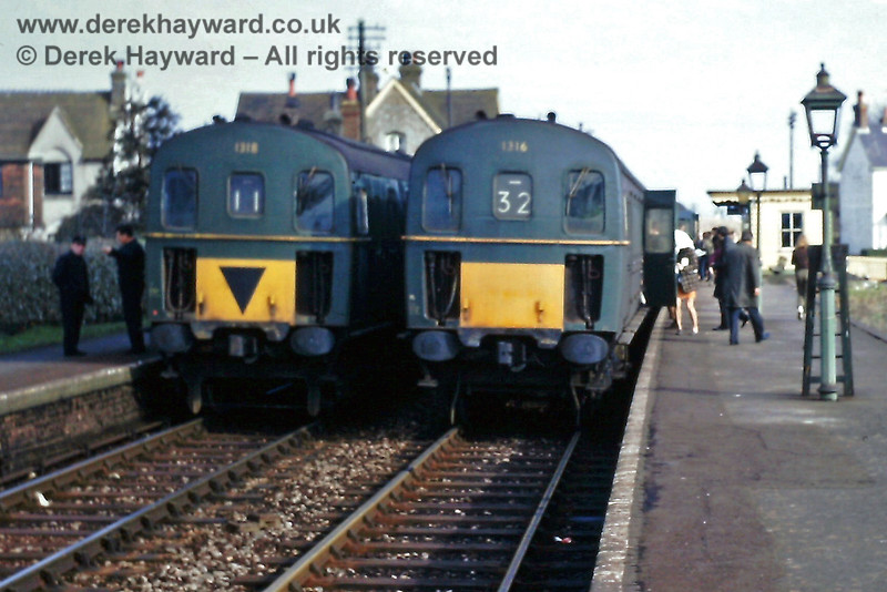 """Barcombe Mills station, looking north, on Sunday 23.02.1969 1316 has arrived on the 10:58 service from Tonbridge.   1318 waits on the adjacent platform with the 12:00 """"wrong line"""" shuttle service to Lewes.  Eric Kemp retains all rights to this image."""