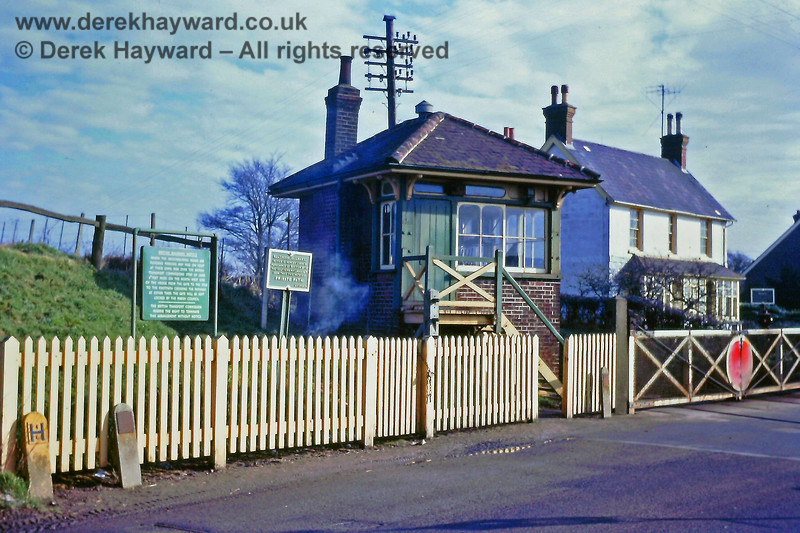 """Barcombe Mills signal box and level crossing, photographed on 23.02.1969.  The notice to the left of the signal box refers to a """"Private Path"""" as opposed to the more common """"Private Road"""" and is assumed to refer to the path behind the signal box.  Something appears to be burning, but it's certainly not coming from the chimney...!   Eric Kemp retains all rights to this image."""