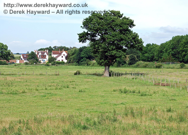 Using a longer lens, this is the cluster of buildings around Barcombe Mills Station, looking east from the Barcombe embankment.  17.06.2007