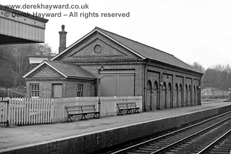 The northern end of Uckfield goods shed, where there was a second door with rail access, but it only led to a short length of line that was fenced off from the platform. In practice empty wagons were rolled forward from the goods shed into the area, to allow others to be unloaded. 30.12.1969.  Eric Kemp retains all rights to this image.