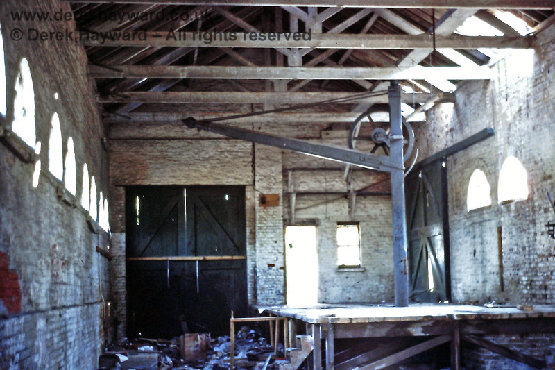 Inside Uckfield goods shed on 25.05.1991.  It is always sad to see these buildings disused and full of debris, but, at the time, the crane had survived.  Eric Kemp retains all rights to this image.