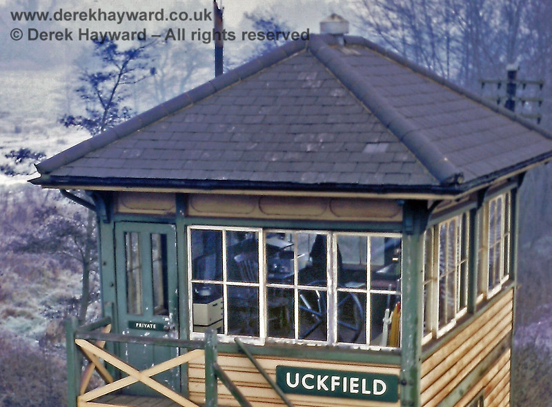 Uckfield Signal Box on 01.01.1969.  A greatly enlarged version of the photo above shows the gate wheel, the lever frame, a wooden chair, a kettle on the stove and a bowl for washing up.  Eric Kemp retains all rights to this image.