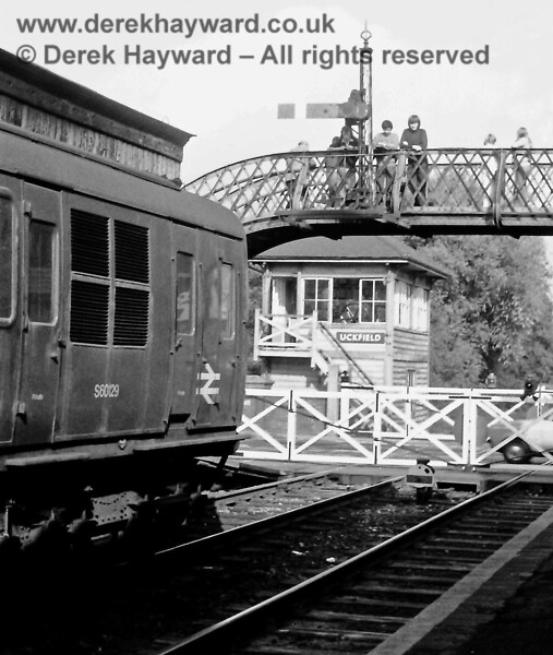 1304 waits to depart from Uckfield with the 16:12 to Victoria on Saturday 18.09.1976.  In those years the footbridge formed a handy viewing point for watching the trains.  Eric Kemp retains all rights to this image.