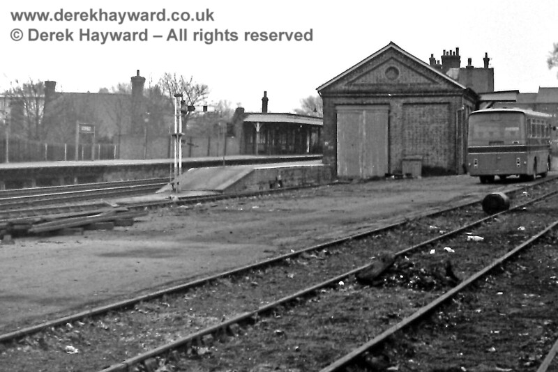 A deserted Uckfield goods yard, which was at the southern end of the station.  The debris on the line suggests that the sidings were, by then, no longer used. In the platform the Down Starting signal stands at danger.   30.12.1969.  Eric Kemp retains all rights to this image.
