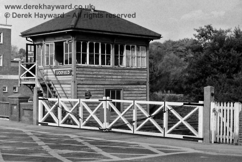 Uckfield signal box, pictured on 18.09.1976.  The level crossing had by then acquired yellow box markings, which were required by national changes to the regulations.  Eric Kemp retains all rights to this image.