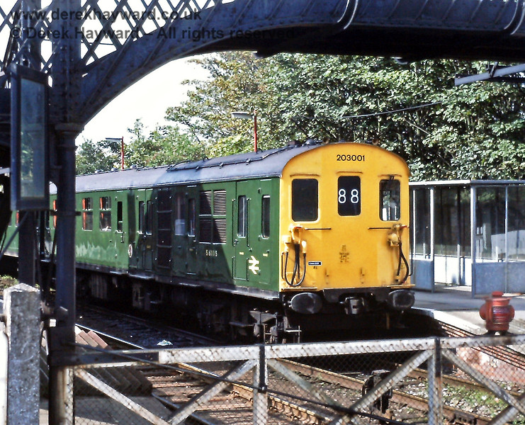 The East Grinstead line gala day on 26.09.1987 resulted in some unusual workings.  203001, better known as Hastings DMU 1001, waits to leave Uckfield with the 12:42 to Oxted.  Eric Kemp retains all rights to this image.
