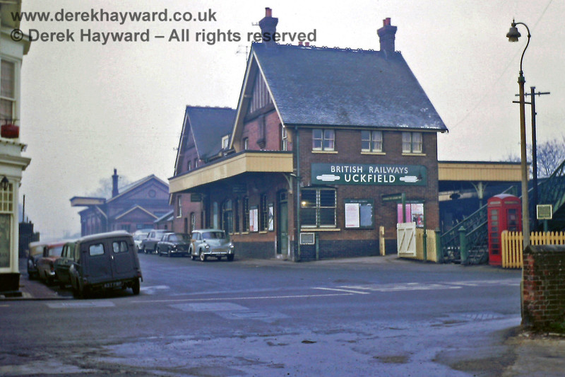 I am grateful to Eric Kemp for allowing me to include some of his historical images in this gallery.  Uckfield station building, viewed from the road side on a damp and murky day on 01.01.1969.  The main road runs from left to right at the bottom of the picture and the level crossing is out of shot on the right.  Straight ahead the road leads only to the distant goods shed, although a public house is also located on the left hand side of the road.   A traditional telephone box stands at the bottom of the footbridge; there were no mobile phones in those days.  Eric Kemp retains all rights to this image.
