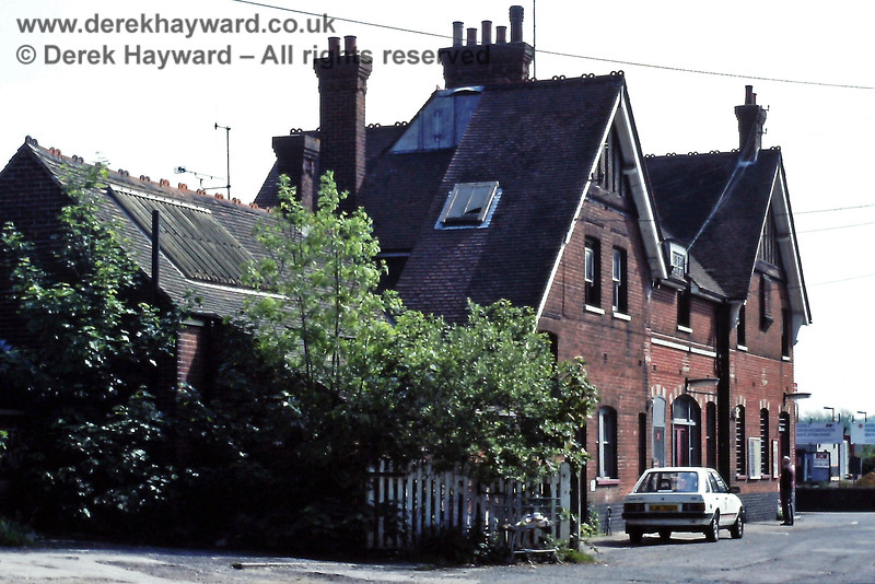 The former station building at Uckfield, viewed looking north from the goods yard, on 25.05.1991.  In the distance, to the right of the building, two lights can be seen on the platform of the new single line station.  Eric Kemp retains all rights to this image.