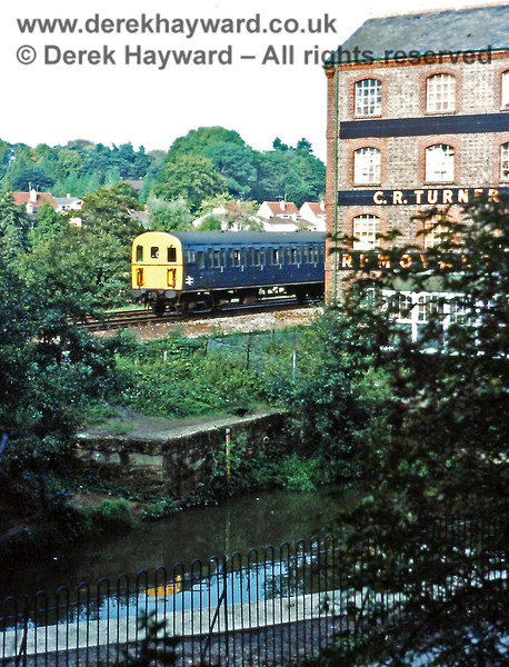 1314 passes the old mill at Uckfield with the rear portion of the 15:09 from Victoria on Saturday 18.09.1976.  In those years the train split at Oxted (departure 15:54) with the front portion going to East Grinstead.  Dividing at Oxted stopped when the East Grinstead line was later electrified.  Eric Kemp retains all rights to this image.