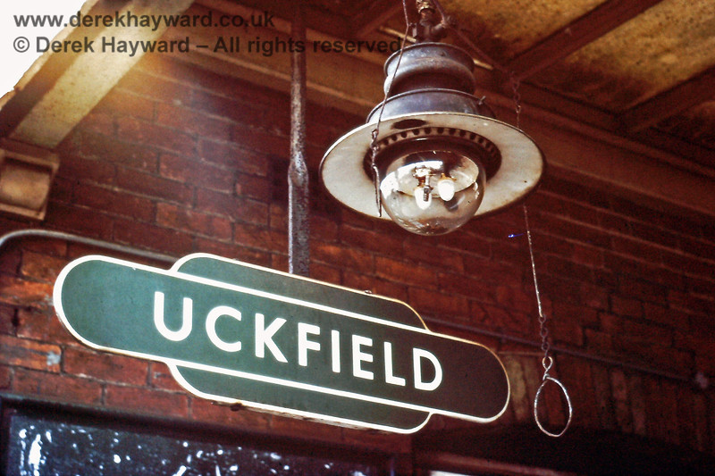 One of the Uckfield gas lamps and target signs, pictured in September 1976.  Unlike many stations on the line (which used oil) Uckfield had a supply of gas for it's lighting.  There was a gas works at the southern end of the station, opposite the Shunting Box.  Eric Kemp retains all rights to this image.