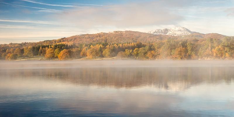 Autumn mist on Windermere lake