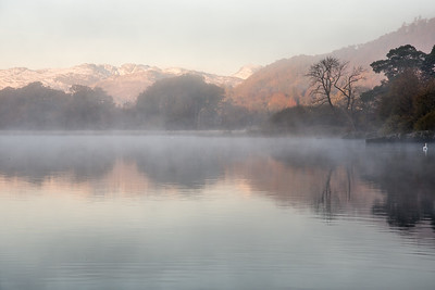 Misty autumn morning on Windermere lake