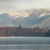 Snow capped fells above Windermere town, hiding the rise of the Kirkstone Pass beyond.