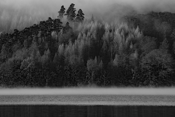 The morning misting rising from the surface of Windermere on the far shore, while mist is still hanging in the trees above.  The gap between was a picture not to be missed.