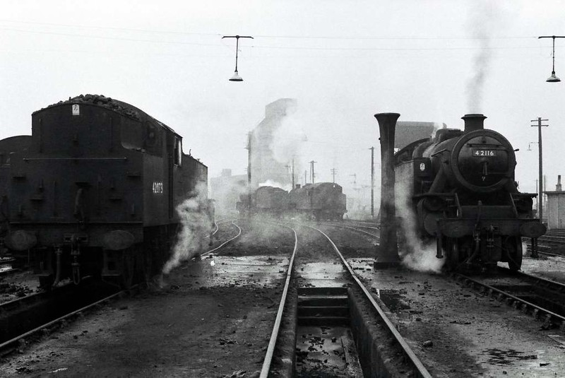 42073 & 42116, Low Moor shed, Bradford, 30 December 1966.  42073 was purchased for preservation upon withdrawal, and has been on the Lakeside & Haverthwaite Railway since 1970.