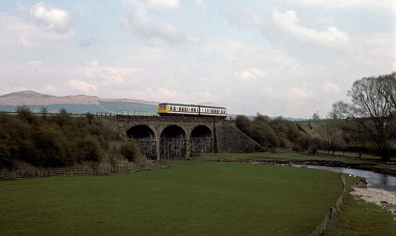 Class 108 DMU, Gargrave, 24 April 1976.    E56204 leads a refurbished DMU over the River Aire on a Leeds - Morecambe service. Photo by Les Tindall.