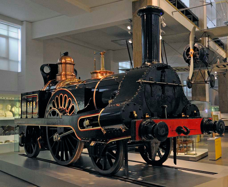 London & North Western Rly 2-2-2 1868, Science Museum, London, 26 April 2013.  Originally Grand Junction Rly No 49 Columbine.  Built in 1845 to a design by Richard Trevithick's son Francis, the GJR's locomotive superintendent.  It was the 20th of over 7000 locos built at Crewe.