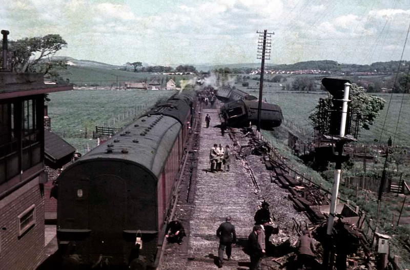 Hest Bank accident, 20 May 1965 1. The 1V42 2210 Glasgow - Kensington Olympia sleeper was derailed by a broken rail just north of the station at about 0220.  D1633 and the first three coaches were not derailed, but the remaining nine coaches were divided into two portions.  The rearmost portion is in the distance at right.  There were no fatalitities and only eleven minor injuries. Photo by Bill Moorby.