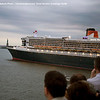 QE2 passing QM2 in NY harbor with Statue of Liberty ahead. Nee the NY chart pictures for positions.