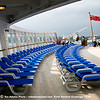 2 rows of deck chairs on the stern while docked in NYC.
