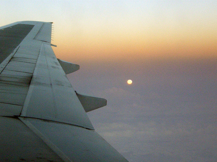 Flying above the moon on the way to England and the adventure that awaits.<br /> OLYMPUS DIGITAL CAMERA