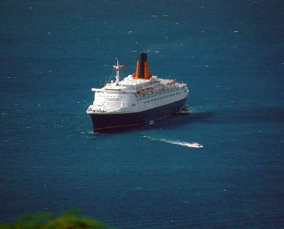 Off St Thomas.   Picture dated 12/31/02. Might have been when I scanned it from NEG. I went on several HAL trips over new years. We saw QE2 or QM2 several times on the last day of the year. I have a bunch more of this type shot.