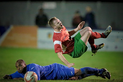 Stephen Bromley is upended by Daniel Brown in the first half. The Campion player was shown a straight red for this challenge.