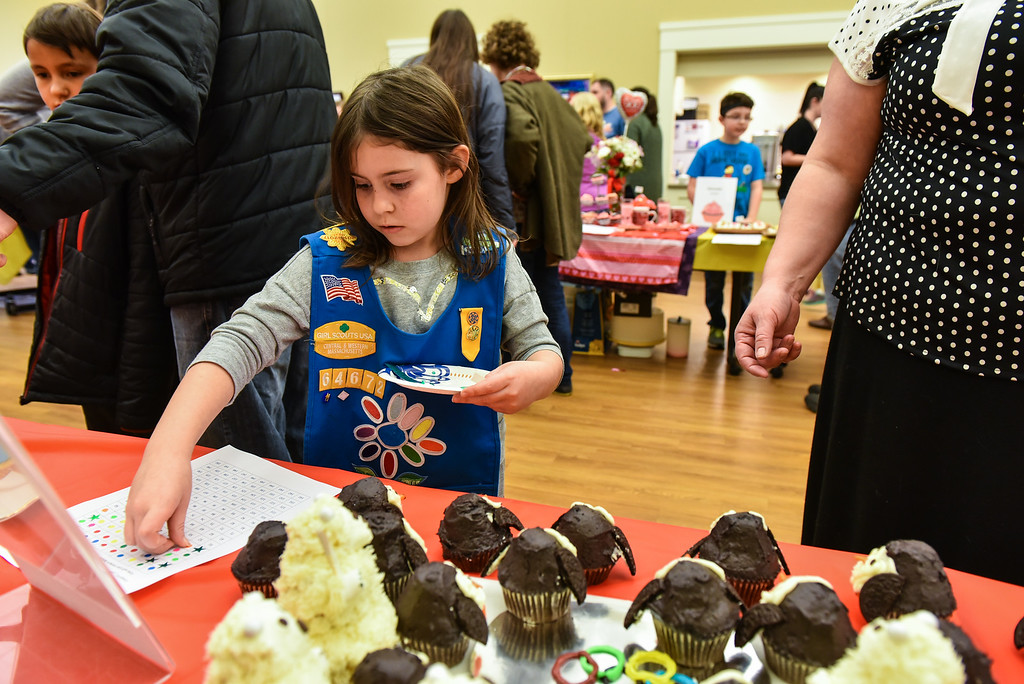 . (02/11/18 TOWNSEND MA) Leeann Congdon, 7, rates the penguin cupcakes at the Townsend Public Library\'s Cupcake Festival on Sunday. SENTINEL & ENTERPRISE JEFF PORTER
