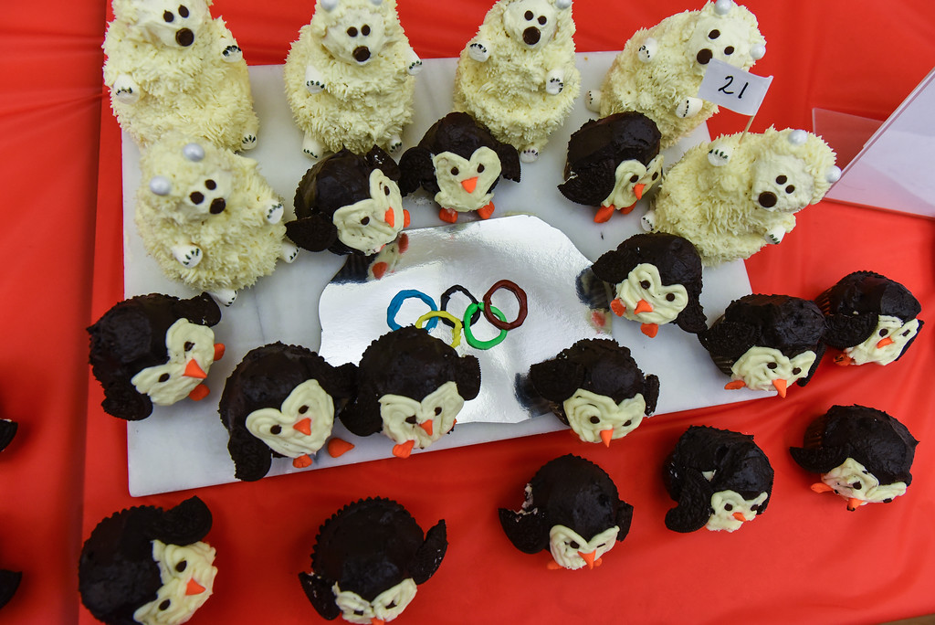 . (02/11/18 TOWNSEND MA) Cupcakes which take the form of polar bears and penguins are made in spirit of the 2018 Winter Olympic Games on Sunday at the Townsend Public Library\'s Cupcake Festival. SENTINEL & ENTERPRISE JEFF PORTER