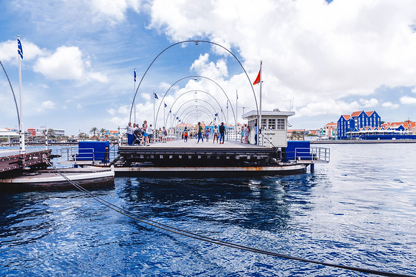 The Queen Emma Bridge is a moving bridge across St. Anna Bay in Willemstad connecting the Punda and Otrobanda districts. The pontoon bridge swings open to let ships go in and out of the harbour. When it opens pedestrians are transported free of charge by a small ferry.