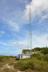 Building and antennae of Radio Hoyer solar energy. On the plateau above the building are the solar panels