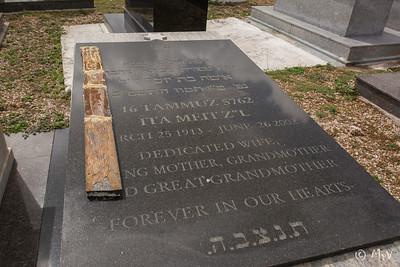 Row DD. Row 2.  Ita Meit.  Marble trim lies on top of stone.