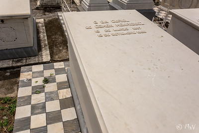 Row TC (row 2) #6. Olga Curiel de C. Henriquez. broken glass on ground and on grave